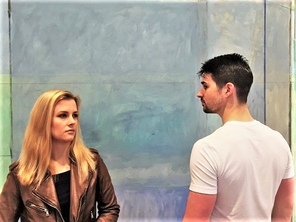Madi and Zach in front of Richard Diebenkorn's 'Ocean Park #60' at the Anderson Collection at Stanford University